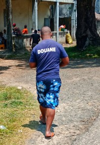 He's with customs, it says so on his shirt!