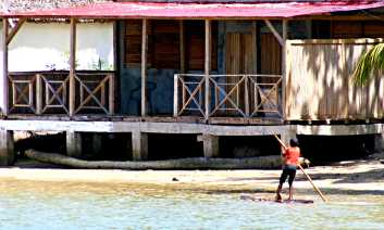 Poling his raft