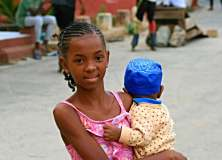 Girl carrying baby